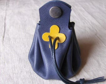 Coin purse is blue leather with yellow clover