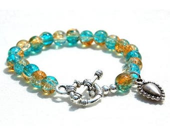 Bracelet jewelry glass and sterling silver charm, turquoise and honey