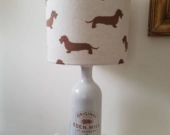 Gin bottle lamp with handmade lampshade in wire dachshund fabric