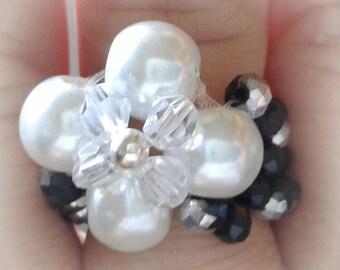 Braided black and white flower ring