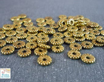 50 beads gold spacer 7mm, (pm101) gold metal flowers