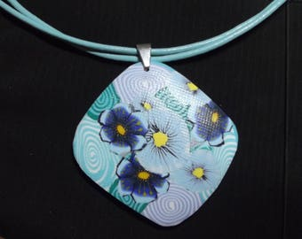 Turquoise necklace and blue sky on a leather cord.