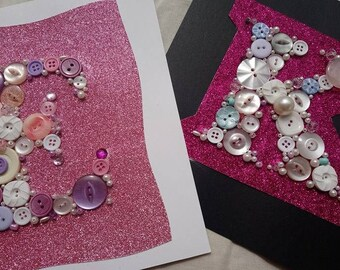 Button and Bead letter, mounted on 8x8'' card