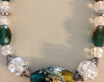 Floral Paradise glass bead with accents of jade, crystal, and browns. Definitely a must have for yourself or a great gift.