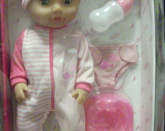 Baby Tinkles NEW doll by Peterkin 15 inches Drink and wet doll