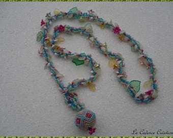 Multicolor long necklace with various beads and shells and beaded bead