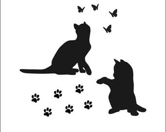 Cat stickers. Silhouettes of cats: vinyl sticker decoration sitting cats, butterflies and Paws