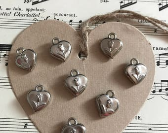Set of pink heart charms