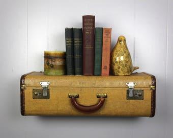 RE:purposed vintage suitcase shelf