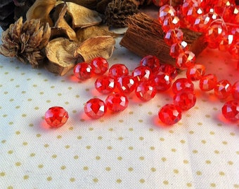 10 Red Crystal, light orange iridescent faceted beads, 6 x 8 mm