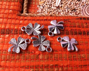 8 small lucky 4 leaf clover, silver and decorated with stripes
