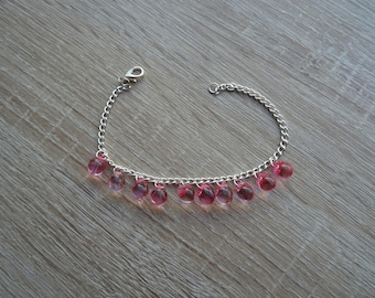 Pink bracelet with chain and beads
