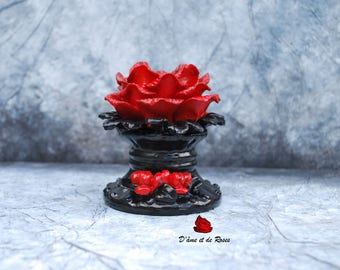 A black Baroque candle holder with Red Roses and candle
