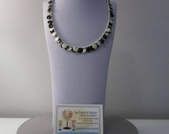Necklace with black and white sequins and metal beads