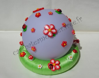 Bright flowers and ladybugs sphere centerpiece