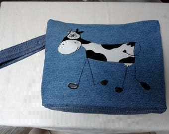 "pouch for makeup or toiletry bag, with ""cow"" oilcloth applique denim"