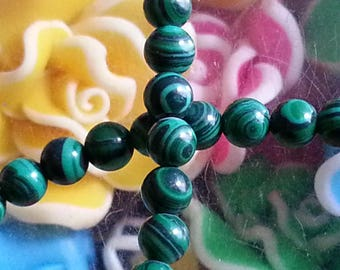 10 4 mm in diameter, hole 1 mm malachite beads.