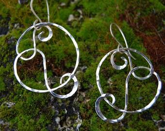 Earrings in sterling silver wire swirls and spirals