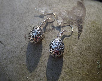 Carved, worked ball earrings