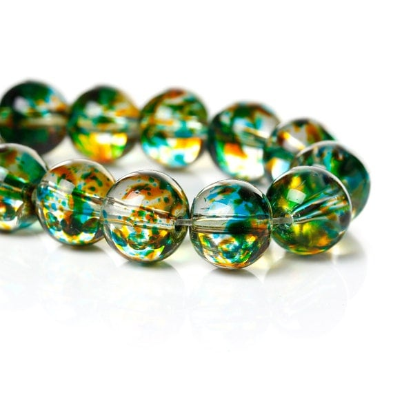 Set of 5 glass beads - green transparent with logo patch - 10 mm