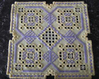 Purple and yellow Hardanger embroidery doily
