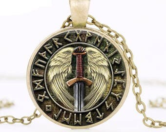A beautiful necklace with a glass cabochon 25 mm Viking sword, Celtic runes