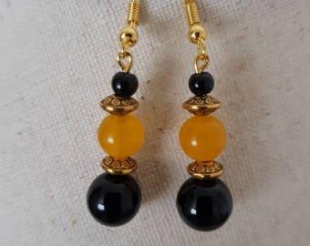 Gold metal mustard yellow jade and black onyx bead hook earrings