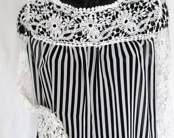 blouse to on your hip with lace trim and lace up side and sleeves