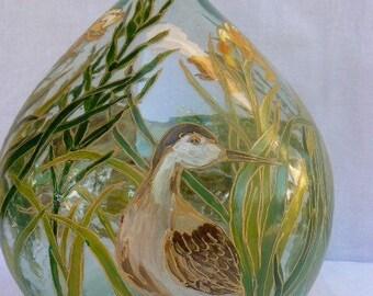 "bottle: ""birds""Knights""in yellow water iris"""