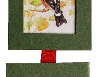 """diptych of frames in cartonnage representing """"The Goldfinch"""" and """"The Bullfinch"""""""