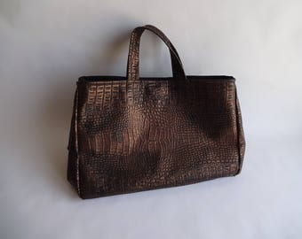 Crossbody bag in faux alligator black and bronze