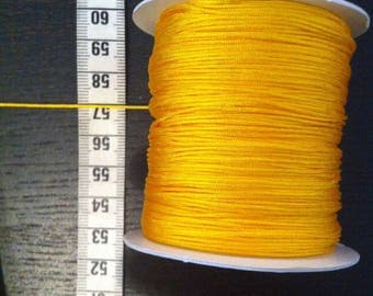 2 meters of mustard yellow 0.8 mm diameter nylon thread