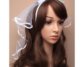 White rosebud aliceband with White veil.