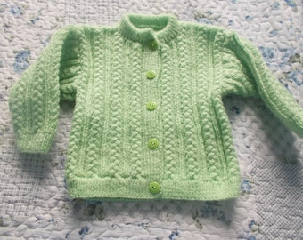 green vest with water girl 1 year