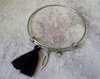 Bangle is stainless steel with black tassel