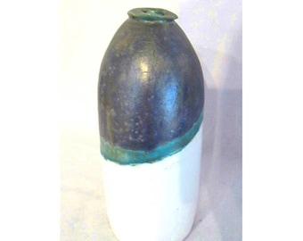 White turquoise blue faience bottle