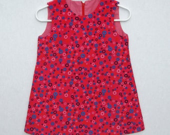 Dress 2 years corduroy fuchsia with small circles, lined.
