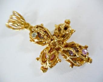 Vintage CHRISTIAN LACROIX cross shape pendant with rhinestones.