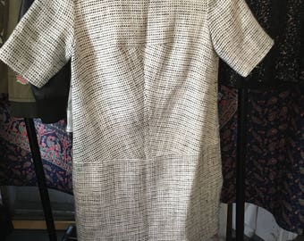 Ecru knit dress with gilded threads