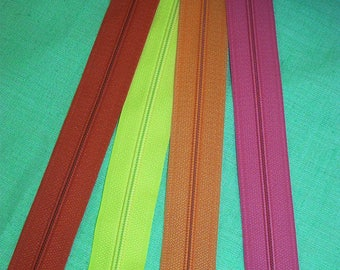 Set of 4 closures zipper 18 cm assorted bright colors pink, red, yellow and orange