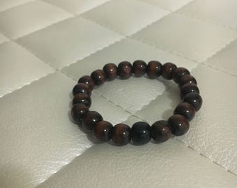 Dark wood beaded bracelet with a touch of black