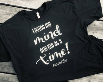Losing my mind one kid at a time tshirt