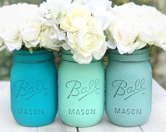 Peacock, aqua, sea foam painted and distressed Mason jars. Outdoor living decor cottage flowers, birthday celebration, baby shower, wedding