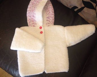 Handknitted babies jacket