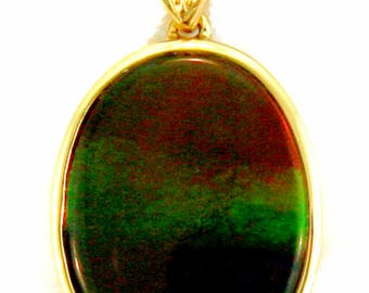 Heart Diamond  Pendant with  Rainbow Ammolite set on 14k  Yellow Gold.