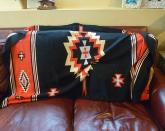 Classic Southwestern pattern fleece throw that can be used for decorating chair, walls, railings, etc