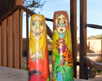 Russian folk art wooden hand carved and painted candle stick pairs.  Each pair signed