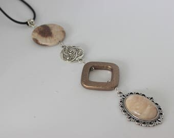Original vertical necklace in acrylic beige, Brown, silver and cabochon.
