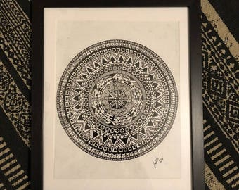 Hand drawn mandala with black frame