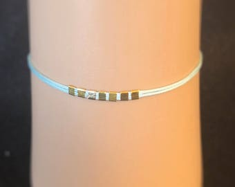 Elegant gold and sky blue bracelet